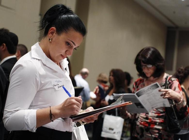A woman fills out an application form from a jewelry and gem company during the Gemological Institute Of America (GIA)'s Jewelry Career Fair in New York July 30, 2012. REUTERS/Shannon Stapleton