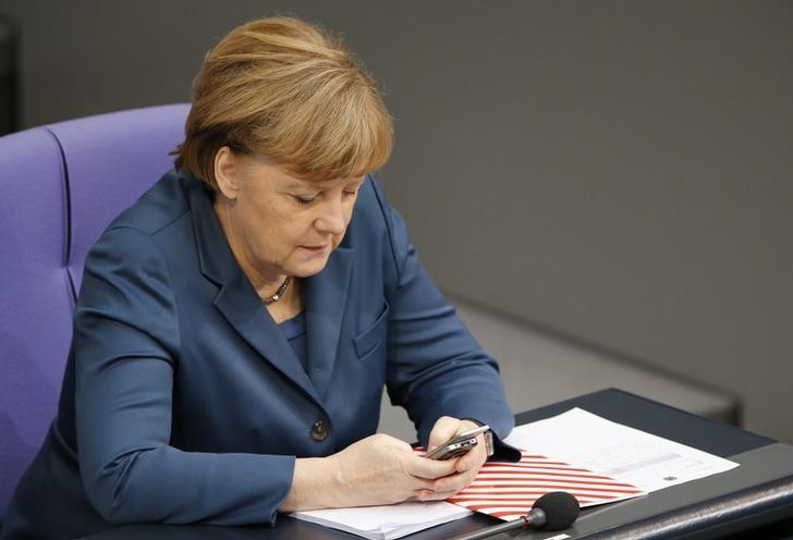 German Chancellor Angela Merkel uses a Nokia slide mobile as she attends a session of the lower house of parliament, the Bundestag in Berlin, November 28, 2013.     REUTERS/Fabrizio Bensch/Files