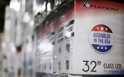 """An """"Assembled in the USA"""" stamp is seen at the side of a box containing a 32-inch television set in the warehouse of Element Electronics, in Winnsboro, South Carolina May 29, 2014.  REUTERS/Chris Keane"""