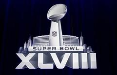 The Super Bowl XLVIII logo is pictured during a news conference ahead of the Super Bowl in New York, January 31, 2014.  REUTERS/Carlo Allegri