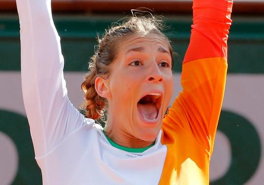 Andrea Petkovic of Germany reacts after winning her women's quarter-final match against Sara Errani of Italy at the French Open tennis tournament at the Roland Garros stadium in Paris June 4, 2014. REUTERS/Jean-Paul Pelissier