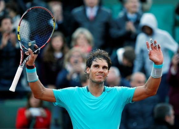 Rafael Nadal of Spain celebrates after winning his men's quarter-final match against his compatriot David Ferrer at the French Open tennis tournament at the Roland Garros stadium in Paris June 4, 2014. REUTERS/Gonzalo Fuentes