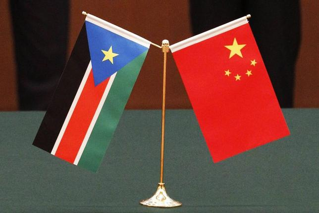 The national flags of South Sudan and China are displayed in front of South Sudan's President Salva Kiir Mayardit and his Chinese counterpart Hu Jintao, during a signing ceremony at the Great Hall of the People in Beijing, in this April 24, 2012 file photo. REUTERS/Kazuhiro Ibuki/Pool/Files
