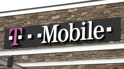 Sprint agrees to pay about $32 billion to buy T-Mobile...