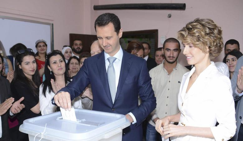 Syria's President Bashar al-Assad and his wife Asma cast their votes in the country's presidential elections at a polling station in Damascus June 3, 2014, in this handout released by Syria's national news agency SANA. REUTERS/SANA/Handout via Reuters