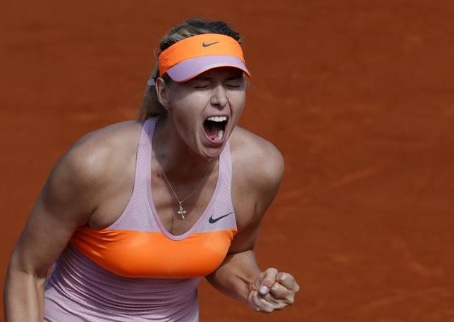 Maria Sharapova of Russia reacts during her women's semi-final match against Eugenie Bouchard of Canada at the French Open tennis tournament at the Roland Garros stadium in Paris June 5, 2014.       REUTERS/Gonzalo Fuentes