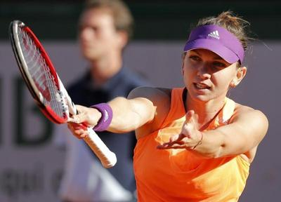 Halep conjures more tricks to reach first slam final
