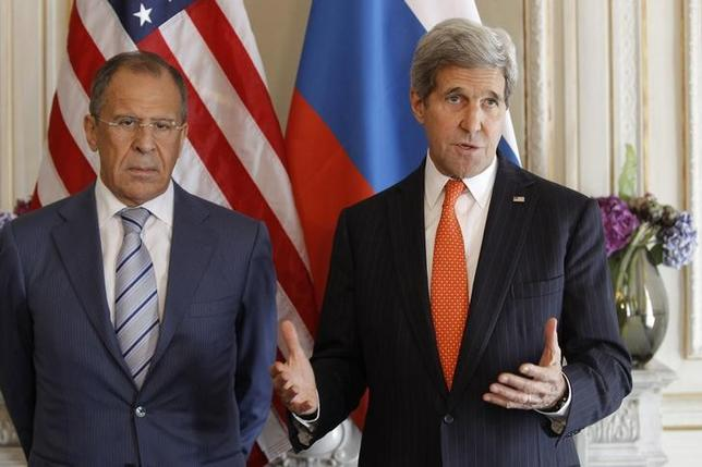 U.S. Secretary of State John Kerry (R) gestures as he stands with his Russian counterpart Sergey Lavrov, before their meeting in Paris, June 5, 2014. Both are in France for the 70th anniversary of the Normandy landings.   REUTERS/Laurent Cipriani/Pool