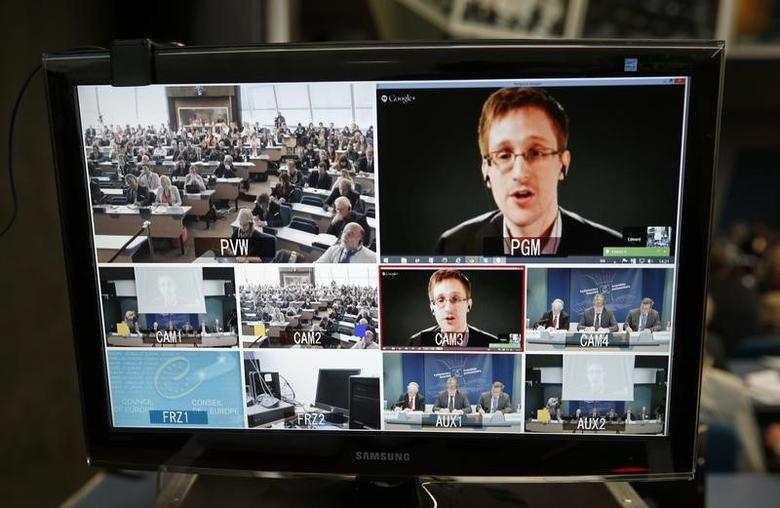 Accused government whistleblower Edward Snowden is seen on a screen as he speaks via video conference with members of the Committee on legal Affairs and Human Rights of the Parliamentary Assembly of the Council of Europe during an hearing on ''mass surveillance'' at the Council of Europe in Strasbourg, April 8, 2014.  REUTERS/Vincent Kessler