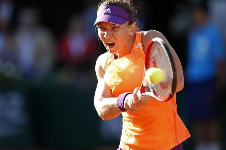 Simona Halep of Romania returns the ball to Andrea Petkovic of Germany during their women's semi-final match at the French Open tennis tournament at the Roland Garros stadium in Paris June 5, 2014. REUTERS/Vincent Kessler