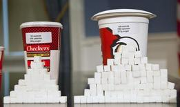 Soft drink cups sized (L-R) at 32 ounces and 64 ounces are displayed at a news conference at City Hall in New York, May 31, 2012. REUTERS/Andrew Burton