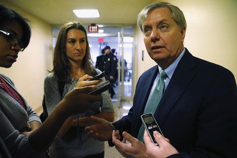Reporters talk to U.S. Senator Lindsey Graham (R-SC) as he arrives for the weekly Republican caucus luncheon at the U.S. Capitol in Washington, November 19, 2013.  REUTERS/Jonathan Ernst