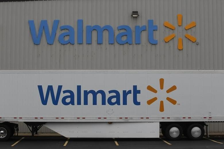 The Wal-Mart company logo is seen outside a Wal-Mart Stores Inc company distribution center in Bentonville, Arkansas June 6, 2013 file photo.  REUTERS/Rick Wilking
