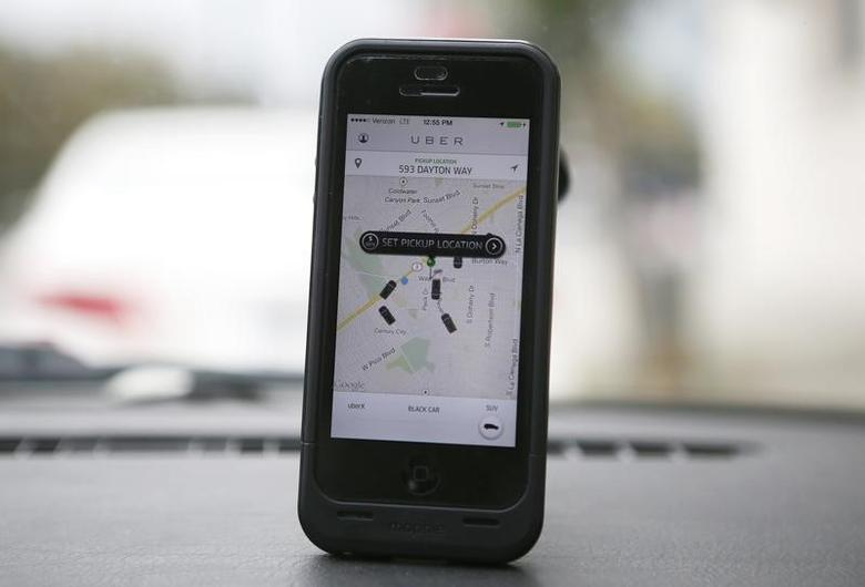 An Uber app is seen on an iPhone in Beverly Hills, California, December 19, 2013. Uber has entered more than 60 markets, ranging from its hometown of San Francisco to Berlin to Tokyo. Leaked financials in December indicate that the company, which began connecting passengers with drivers of vehicles for hire about 3-1/2 years ago, is generating $200 million a year in revenue beyond what it pays to drivers. Photo taken December 19, 2013.  REUTERS/Lucy Nicholson (UNITED STATES - Tags: BUSINESS TRANSPORT) - RTX1705H