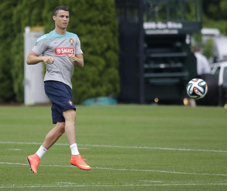 Cristiano Ronaldo of Portugal's National Team attends a practice session for their upcoming friendly soccer matches in the United States at the NFL New York Jets practice facility in Florham Park, New Jersey, June 3, 2014. REUTERS/Ray Stubblebine