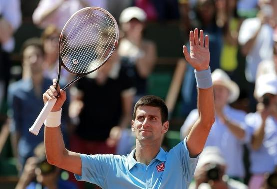 Novak Djokovic of Serbia celebrates after winning his men's semi-final match against Ernests Gulbis of Latvia at the French Open tennis tournament at the Roland Garros stadium in Paris June 6, 2014. REUTERS/Vincent Kessler