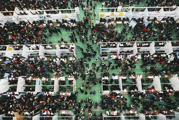 Job seekers attend a job fair at Tianjin University November 22, 2013. REUTERS/Stringer