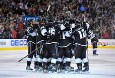Jun 7, 2014; Los Angeles, CA, USA; Los Angeles Kings players celebrate after defeating the New York Rangers in game two of the 2014 Stanley Cup Final at Staples Center. Mandatory Credit: Gary A. Vasquez-USA TODAY Sports