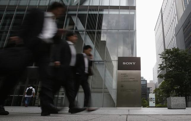 People walk out from Sony Corp's headquarters in Tokyo May 22, 2014. REUTERS/Yuya Shino