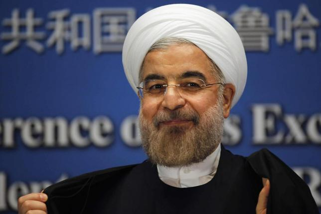 Iran's President Hassan Rouhani smiles as he leaves a news conference at a hotel after the fourth Conference on Interaction and Confidence Building Measures in Asia (CICA) summit, in Shanghai May 22, 2014. REUTERS/Carlos Barria