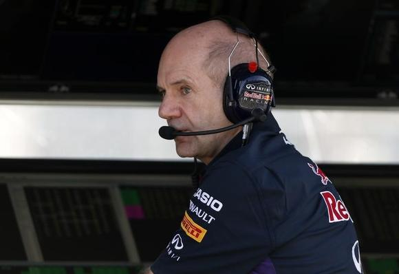 Red Bull Formula One technical chief Adrian Newey speaks on the radio during the second practice session of the Australian F1 Grand Prix at the Albert Park circuit in Melbourne March 14, 2014. REUTERS/Brandon Malone (AUSTRALIA  - Tags: SPORT MOTORSPORT F1)   - RTR3H1EG
