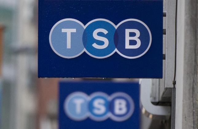 Signs are seen outside of a branch of TSB bank in London May 27, 2014.  REUTERS/Neil Hall