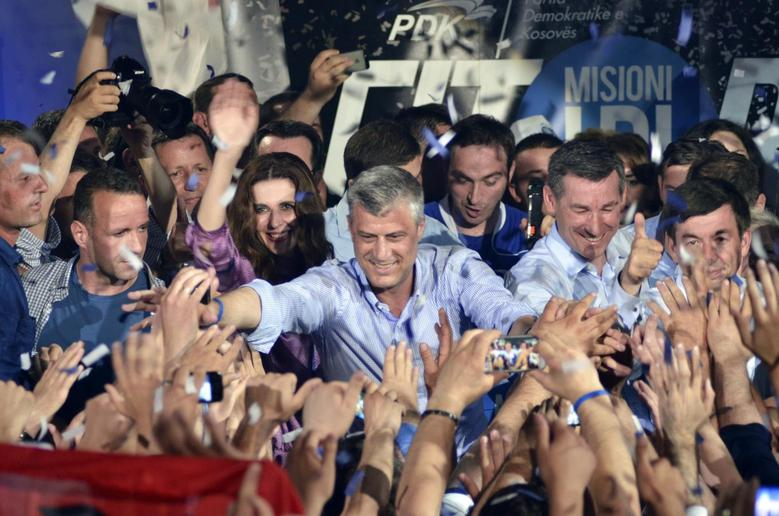Leader of the Democratic Party of Kosovo (PDK), Kosovo's Prime Minister Hashim Thaci celebrates with his supporters after the party claimed victory and Thaci a likely third term as Prime Minister, in Pristina June 9, 2014. REUTERS/Hazir Reka