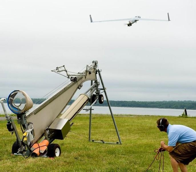 Personnel at a Navy testing facility in Dahlgren, Virginia, launch an Insitu ScanEagle unmanned aerial vehicle during a demonstration for leaders from the Coast Guard Acquisition Directorate in this May 3, 2012 handout photo obtained by Reuters December 5, 2012. The ScanEagle is scheduled to deploy aboard the Coast Guard Cutter Stratton in the summer. REUTERS/U.S. Coast Guard/Petty Officer 1st Class Andrew Kendrick/Handout