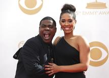 "Actor Tracy Morgan from NBC's sitcom ""30 Rock"" and wife, Sabina Morgan, arrive at the 65th Primetime Emmy Awards in Los Angeles September 22, 2013. REUTERS/Mario Anzuoni"