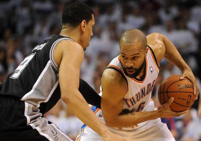 May 31, 2014; Oklahoma City, OK, USA; Oklahoma City Thunder guard Derek Fisher (6) handles the ball against San Antonio Spurs guard Danny Green (4) during the second quarter in game six of the Western Conference Finals of the 2014 NBA Playoffs at Chesapeake Energy Arena. Mandatory Credit: Mark D. Smith-USA TODAY Sports - RTR3RNY3