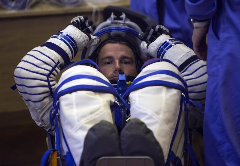 The International Space Station crew member Reid Wiseman of the U.S. looks on during his space suit check at the Baikonur cosmodrome May 28, 2014. REUTERS/Shamil Zhumatov