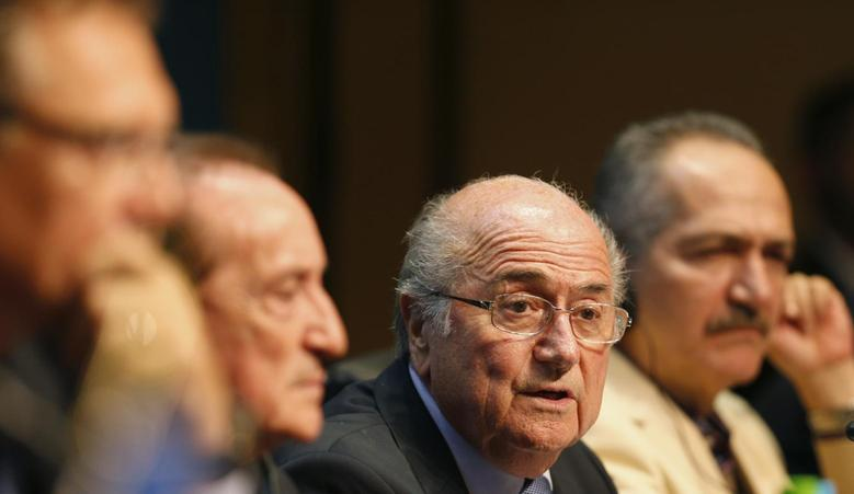 FIFA President Sepp Blatter (2nd R) attends a media conference in Sao Paulo June 5, 2014. The 2014 World Cup will be held in 12 cities in Brazil from June 12 to July 13. REUTERS/Paulo Whitaker