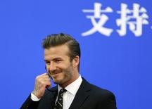 Former captain of England soccer team David Beckham attends a ceremony at the Great Hall of the People in Beijing April 21, 2014 FILE PHOTO.  REUTERS/Jason Lee