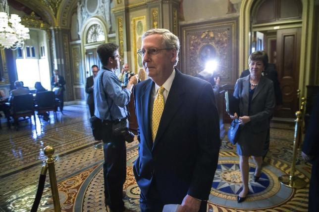 U.S. Senate Minority Leader Mitch McConnell (R-KY) (C) walks to speak to reporters after the weekly Republican party caucus luncheon at the U.S. Capitol in Washington June 10, 2014. Also pictured is Senator Susan Collins (R-ME) (R). REUTERS/Jonathan Ernst