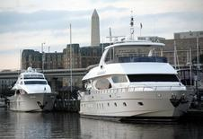 Private motor yachts are docked at Gangplank Marina in Washington October 19, 2010.  REUTERS/Molly Riley