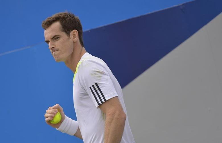 Britain's Andy Murray reacts during his men's singles tennis match against France's Paul-Henri Mathieu at the Queen's Club Championships tennis tournament in west London, June 11, 2014. REUTERS/Toby Melville