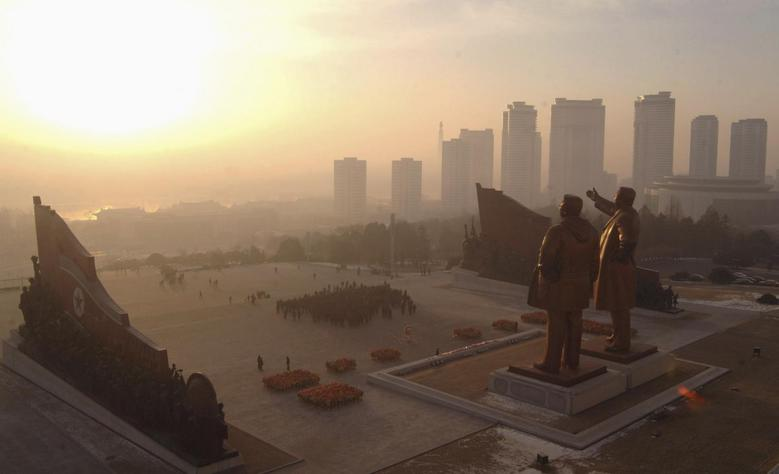 North Koreans celebrate the New Year by visiting statues of North Korea's founder Kim Il Sung and former leader Kim Jong Il at Mansudae hill in Pyongyang, in this January 1, 2014 file photo released by North Korea's Korean Central News Agency (KCNA) in Pyongyang. REUTERS/KCNA/Files
