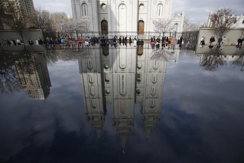 People walk past Salt Lake temple as they arrive to attend the biannual general conference of the Church of Jesus Christ of Latter-day Saints in Salt Lake City, Utah April 5, 2014. REUTERS/Jim Urquhart