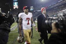 Jan 19, 2014; Seattle, WA, USA; San Francisco 49ers quarterback Colin Kaepernick (7) walks off the field after the 2013 NFC Championship football game against the Seattle Seahawks at CenturyLink Field. Mandatory Credit: Joe Nicholson-USA TODAY Sports