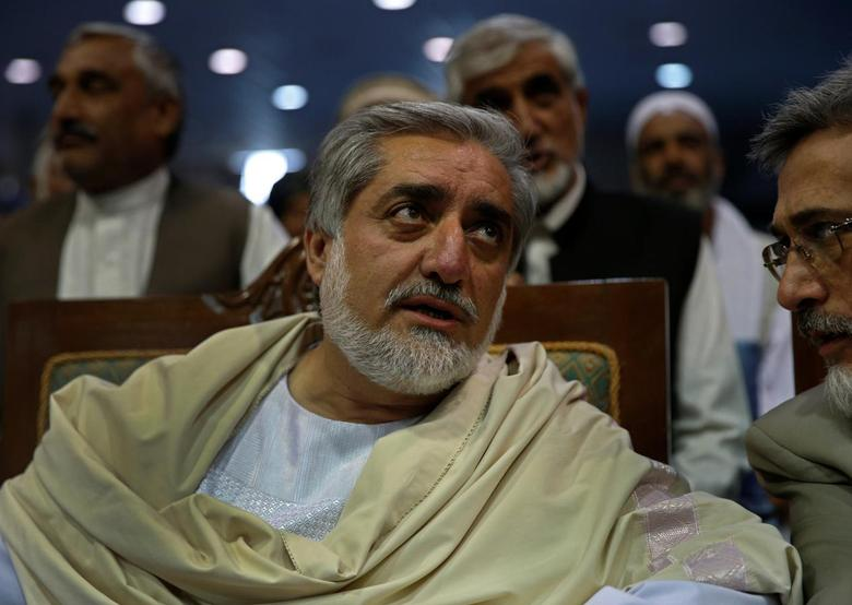 Afghan presidential candidate Abdullah Abdullah attends the last day of election campaigns in Kabul June 11, 2014. The second round of Afghanistan's presidential election will take place on June 14. REUTERS/Ahmad Masood