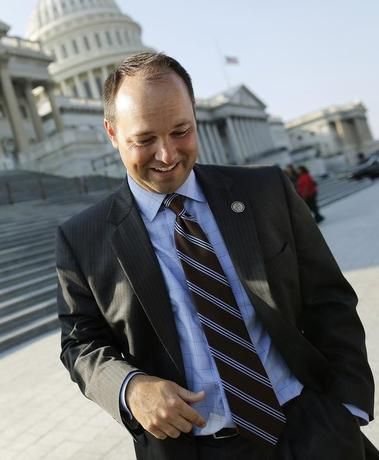 U.S. Representative Marlin Stutzman (R-IN) talks to a reporter outside the U.S. Capitol in Washington September 11, 2013.  REUTERS/Jonathan Ernst