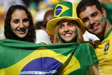 Brazilian fans pose during the opening ceremony of the 2014 World Cup at the Corinthians arena in Sao Paulo June 12, 2014. REUTERS/Damir Sagolj