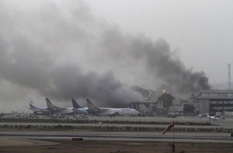 Smoke billows from Jinnah International Airport in Karachi June 9, 2014. REUTERS/Athar Hussain