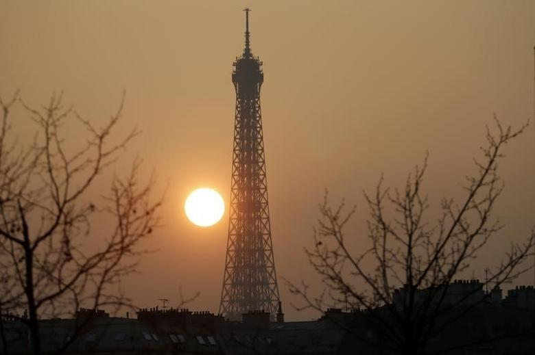 The Eiffel tower is pictured during sunset in France, March 14, 2014. REUTERS/Charles Platiau
