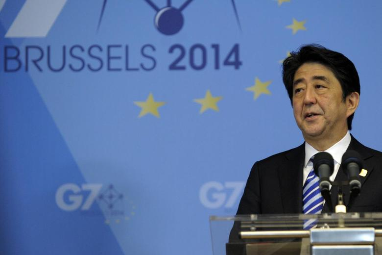 Japan's Prime Minister Shinzo Abe holds a news conference at the end of the G7 summit at the European Council headquarters in Brussels June 5, 2014. REUTERS/Laurent Dubrule