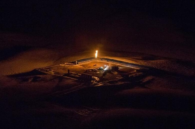 An aerial image shows a natural gas flare after sunset outside of Williston, North Dakota March 12, 2013. REUTERS/Shannon Stapleton