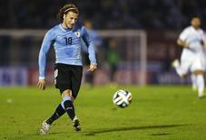Jogador uruguaio Diego Forlán durante amistoso contra a Eslovênia em Montevidéu. 4/06/2014.   REUTERS/Andres Stapff