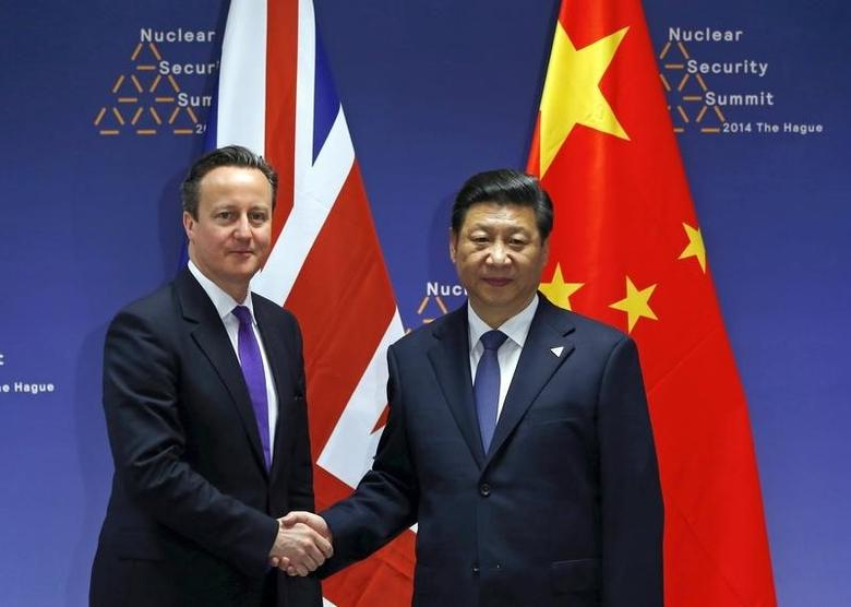 Britain's Prime Minister David Cameron (L) meets with China's President Xi Jinping during the Nuclear Security Summit in The Hague March 25, 2014. REUTERS/Yves Herman