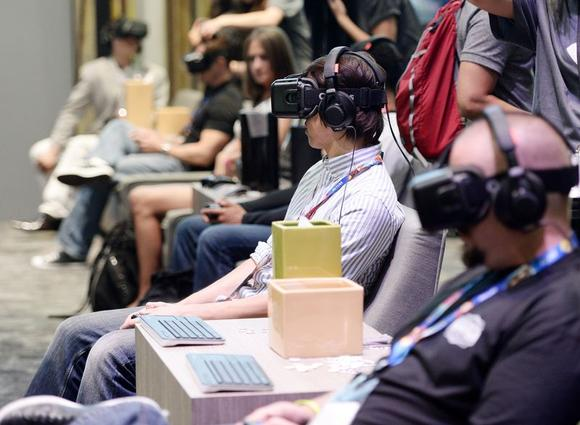 Attendees use Oculus Rift virtual reality headsets at the 2014 Electronic Entertainment Expo, known as E3, in Los Angeles, California June 11, 2014.REUTERS/Kevork Djansezian