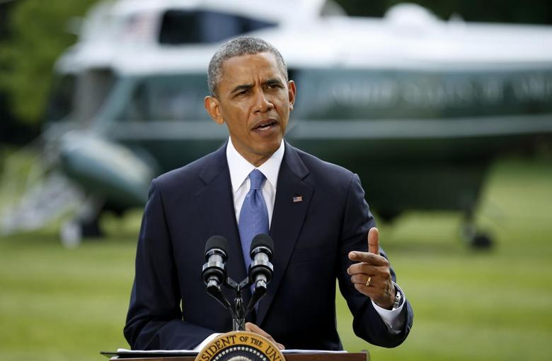U.S. President Barack Obama speaks about the situation in Iraq from the South Lawn of the White House in Washington June 13, 2014.  REUTERS/Kevin Lamarque